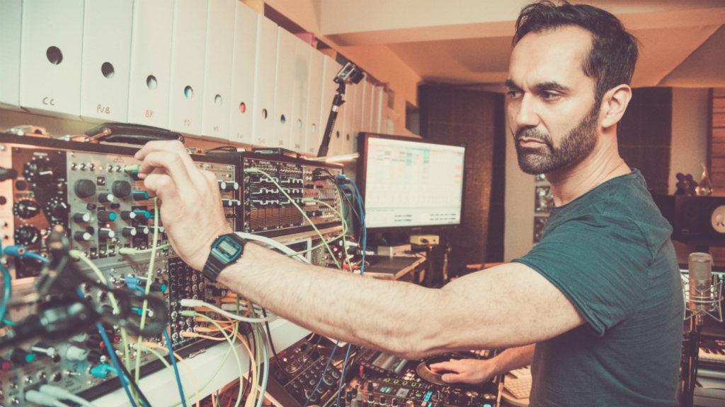 Punjabtronix residency - image of DJ Swami in the studio