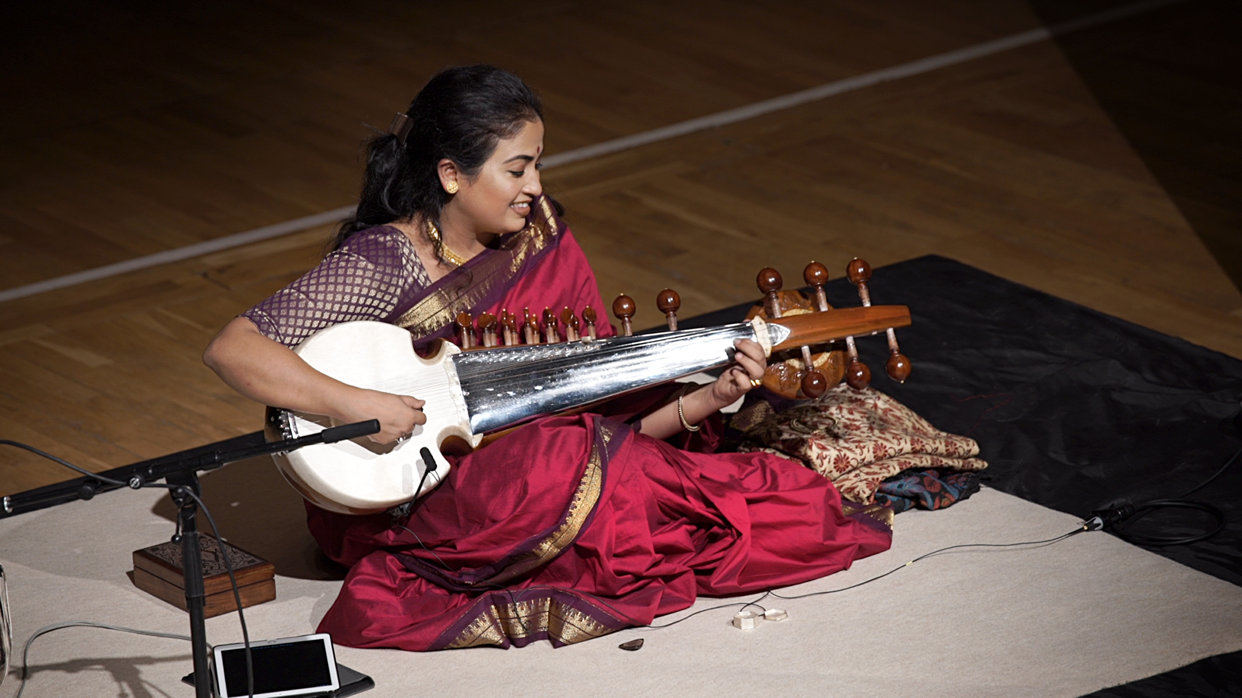 A photo taken from the balcony of Debasmita playing the sarod on stage at St George's.