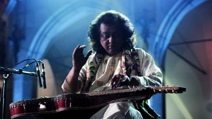 Slide guitar maestro, Debashish Bhattacharya performing on stage.