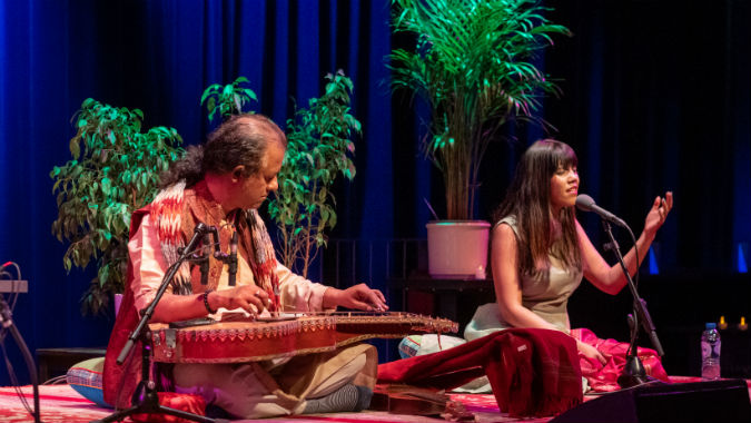 Debashish Bhattacharya Trio performing in concert.